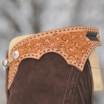 Finger cut yokes with buckstitch detail.  Silver overly concho and buckle, loop and tip.  Dark brown split leather.