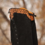 Black topgrain leather rough side out. Daisy design dark black/brown dye to edges.