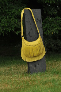 Fringe hip purse.